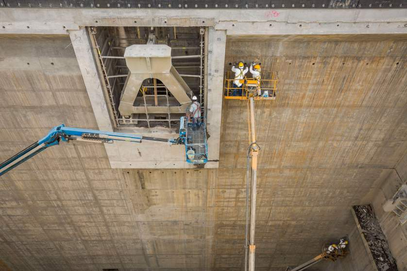 Workers make final refinements to the concrete and steel slot that will hold the last gate on the Pacific side of the Panama Canal Expansion project . April 23, 2015.